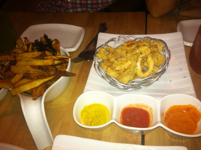 ^^The calamari came with three different dipping sauces. Next to it was our spicy fries and seaweed. Yum!