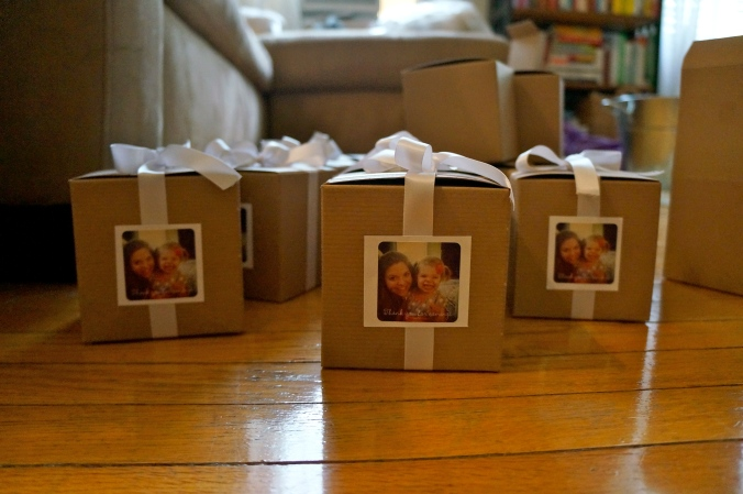 ^^ We lined these cardboard boxes with white ribbon and stuck an adorable photo of Alison and her daughter on two sides. The photos were stickers from Shutterfly, and they said 'Thanks so much for coming!' Guests filled the boxes up with treats from the dessert bar as part of their parting gift.